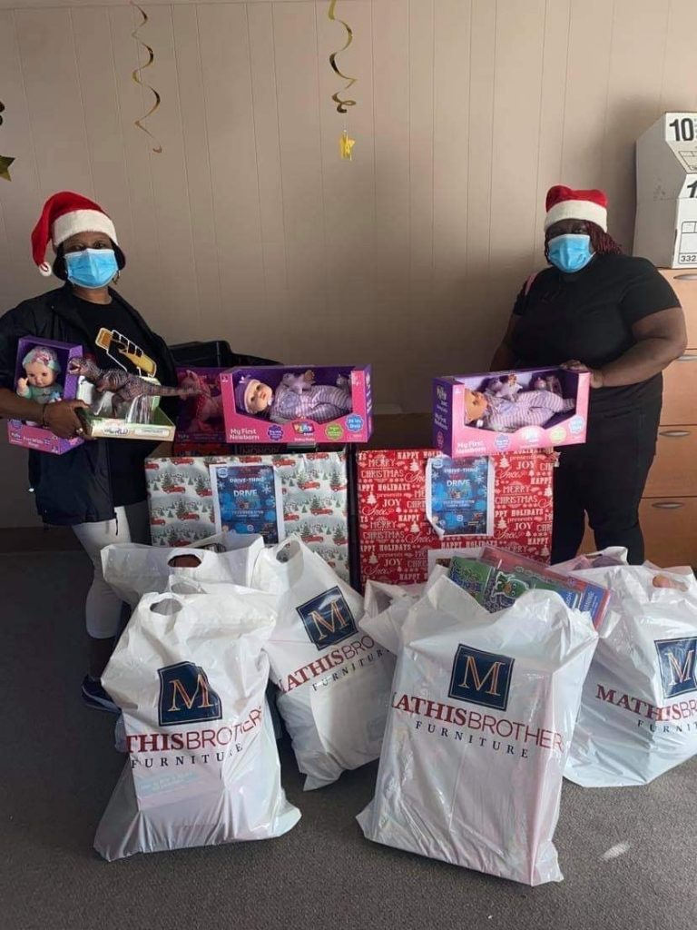 Sistas Making a Difference pose with toys for the Sistas' holiday toy drive
