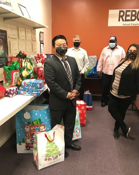 San Bernardino County Public Defenders and Inland Empire Rebound pose with toys for the annual Angel Tree Toy Giveaway