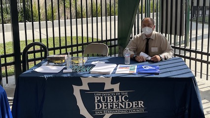 Deputy Public Defender Allen Phou at the San Bernardino County Public Defender table, Fontana CAP Fair 2021